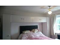 White Over Bed Wardrobe and 2 chest of draws