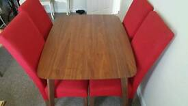 Lovely walnut retro table with red chairs
