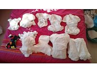 Bundle of reusable nappies, inserts and outer wraps from birth to potty
