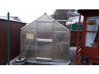 Aluminium greenhouse in good condition with polycarbonate sheeting and slab base