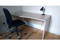 Office desk with chair and lamp