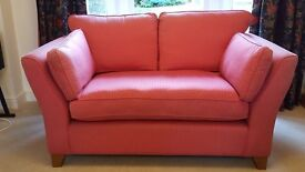 Two seater sofa (Laura Ashley), strawberry pink, in excellent condition.
