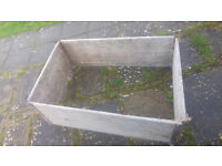 Large wooden planting box. Metal corners and solid heavy food. Easily make a raised bed