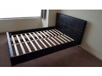 Double bed frame with black faux leather headboard