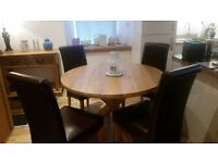 Quality oak dining table and 4 chairs bought last October