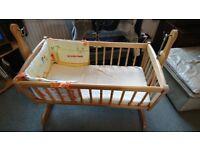 Wooden crib, mattress and bedding