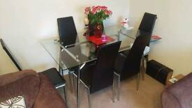 Extending glass table with 6 chairs