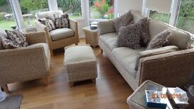 M&S conservatory 3 piece suite with matching pouffe and side tables. Spare cushion covers inc