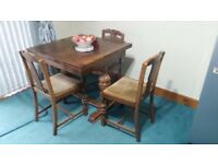 Antique durable solid wood dinning table with 3 chairs that is hard to find