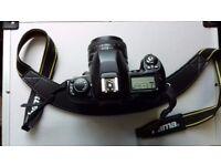 Nikon F80 and 50 mm lens.
