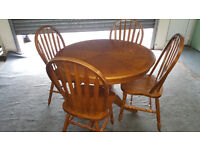 Circular Wooden Dining Table and four chairs