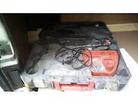 Milwaukee 12 volt battery charger and case