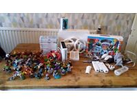Nintendo Wii console with accessories and 49 skylanders figures/traps