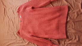 Dark orange knitted jumper with zip up back, size 6, wanting £5