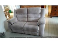 2 seater electric reclining sofa and 1 reclining armchair in cream fabric.