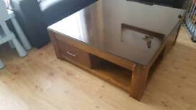 Oak solid wood coffee table with dark glass