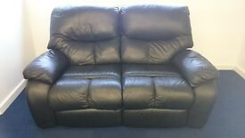 Two seat electric leather reclining sofa. Black in colour. VERY VERY good condition