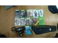 Xbox 360 with 3 controllers and games