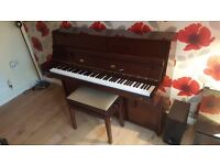 Upright 88 Key Offenbach Piano for sale. In excellent condition. Includes adjustable stool.