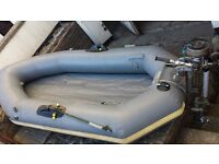 Avon 9 ft inflatable dinghy with outboard motor.