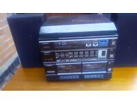 stereo, plays vinyl records, cassette tapes, radio