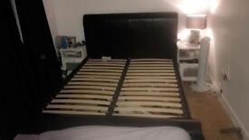Black leather kingsize bed