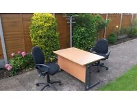Beech effect office desk with grey metal legs, 2 office chairs and a coat stand