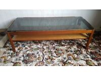 Teak coffee table , with glass top