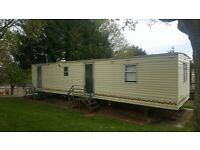 cheap static caravan for sale on a beautiful 11 month park in the english riviera with sea views.