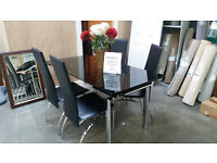 Lovely black glass didning table & 4 high back chairs