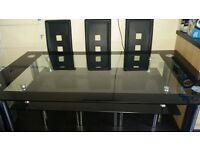 6-8 seater glass dining table with 8 chairs.