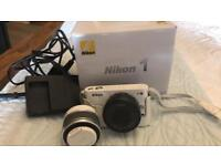 Nikon 1 J2 camera with xtra lens and charger comes with box and instructions