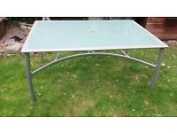 Glass Patio Table with attractive metal frame