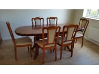 John E Coyle (CB) Cherry dining table and 6 chairs.