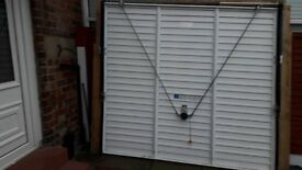Canopy up and over garage door. (Garador) Fitted 2009. Wooden frame attached.