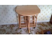 Small kitchen table and matching stools.