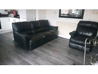 Black leather 3 seater sofa and recliner armchair