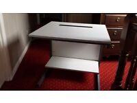Computer desk. 800mm by 750mm. Unmarked and very high quality. Has rear slot for cables.