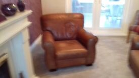 Brown leathet 3 seater sofa and matching armchair