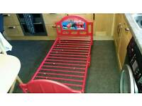 Preowned red toddler bed cotbed size - excellent condition - cars