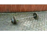 Body sculpture cast iron weight plates and solid barbell, just over 80kg