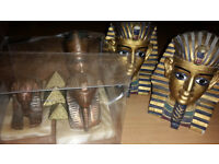 Egyptian head paperweights x 3 and 2 book ends