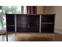 Grey TV Stand - wood, tinted glass sliding door - used but good condition