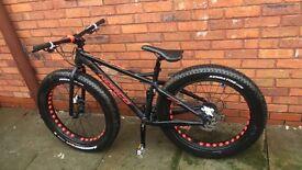 Norco black and red bike big wheels