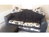 Black 3 seater chenille and faux leather sofa. For charity