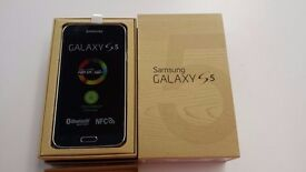 Samsung Galaxy S5 CHARCOAL BLACK in a Box with all the Accessories SIM FREE UNLOCKED To All Networks