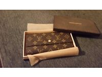Pristine Louis Vuitton purse still in box