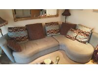 Left facing corner fabric sofa blue and brown with all cushions and an armchair good condition