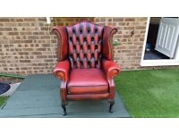 Vintage chesterfield wing back chair.