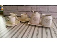 Vintage coffee cups and milk and sugar set